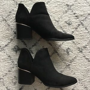 Expression black booties with gold heel accents